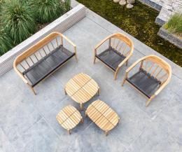 Exklusiver Oasiq Copenhagen Designer Gartensessel mit Tisch und Sofa auf Terrasse